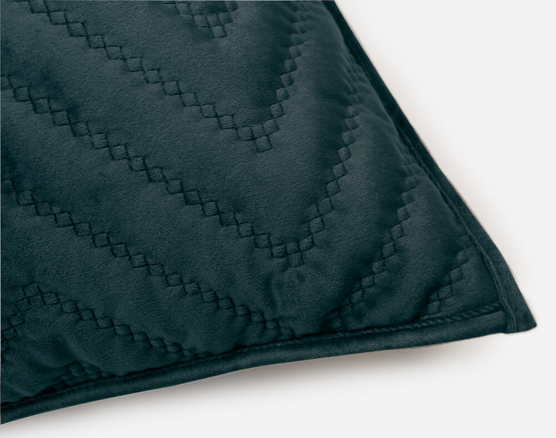 One closed corner of our Quilted Chevron Euro Sham in Teal.