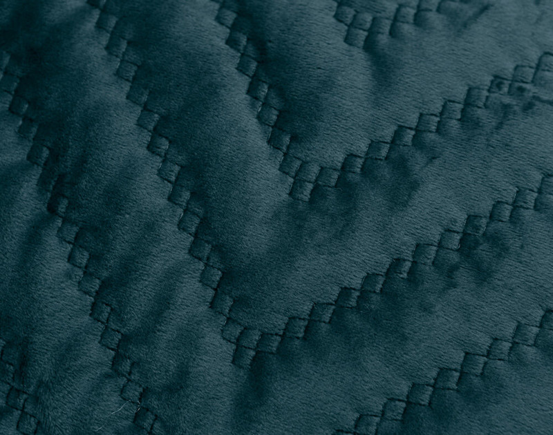 Close-up of the quilted texture of our Quilted Chevron Euro Sham in Teal.