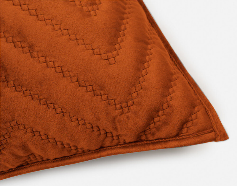 One closed corner of our Quilted Chevron Euro Sham in Copper.