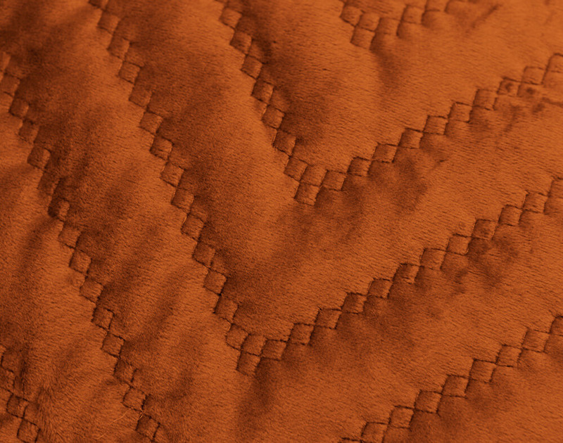 Close-up of the quilted texture of our Quilted Chevron Euro Sham in Copper.