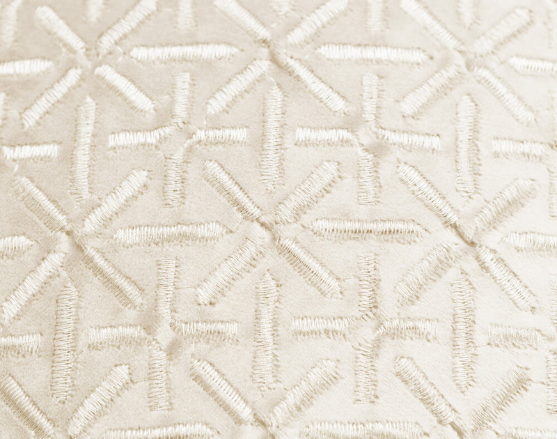 Close-up of the Trellis texture pattern on our Trellis Velvet Square Cushion Cover in Cloud.