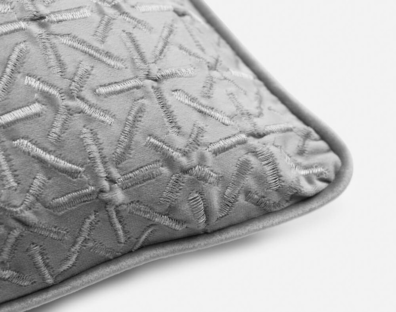 Piped edging on the corner of our Trellis Velvet Square Cushion Cover in Silver.