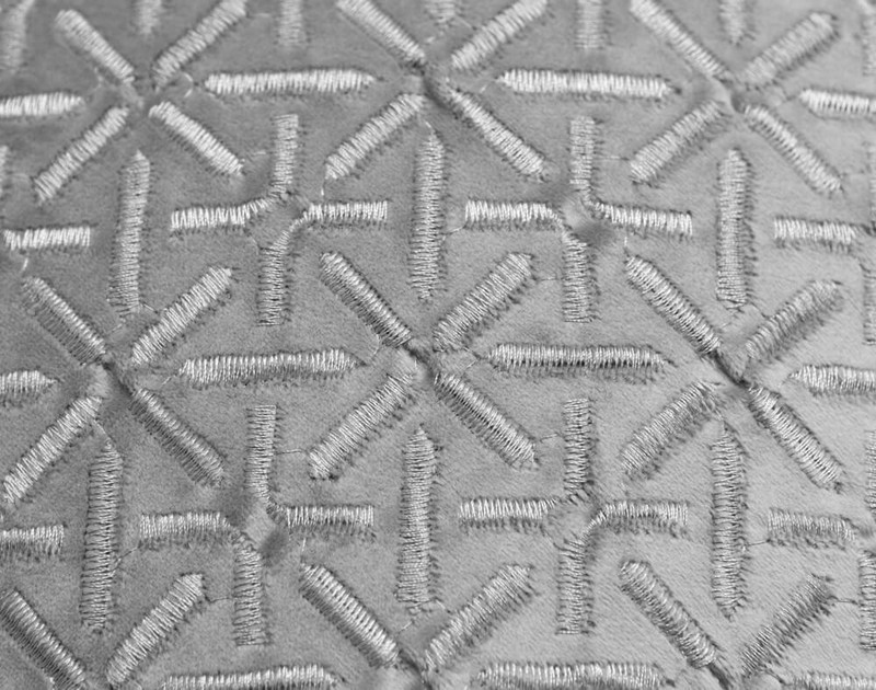 Close-up of the Trellis texture pattern on our Trellis Velvet Square Cushion Cover in Silver.