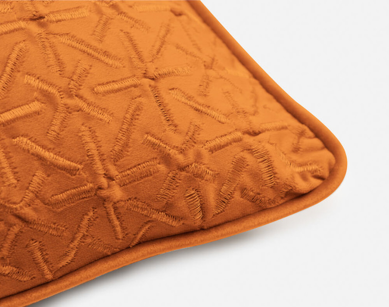 Piped edging on the corner of our Trellis Velvet Square Cushion Cover in Copper.