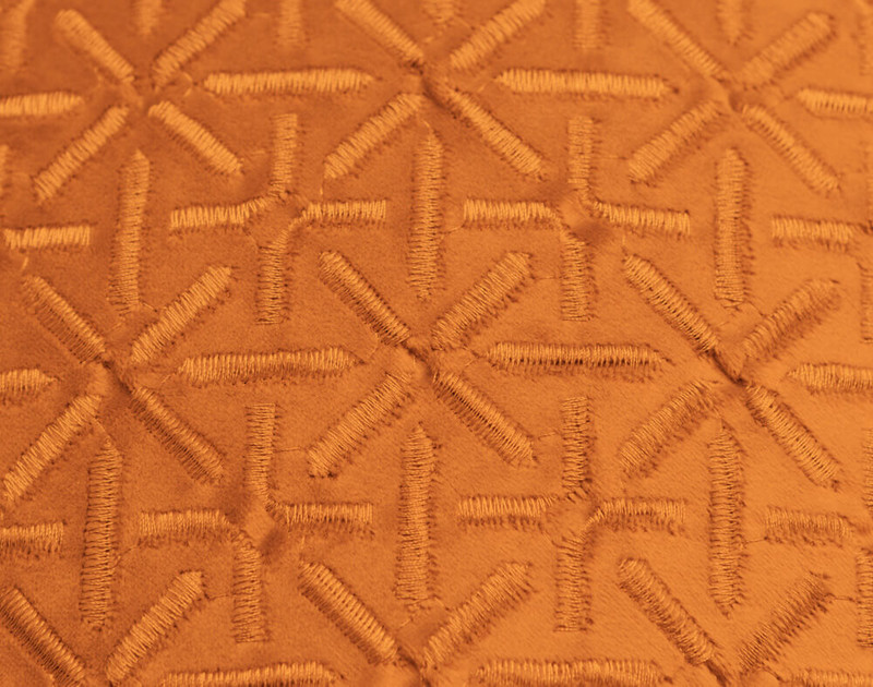 Close-up of the Trellis texture pattern on our Trellis Velvet Square Cushion Cover in Copper.