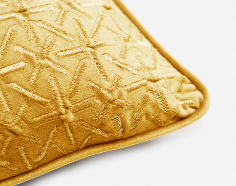 Piped edging on the corner of our Trellis Velvet Square Cushion Cover in Gold.