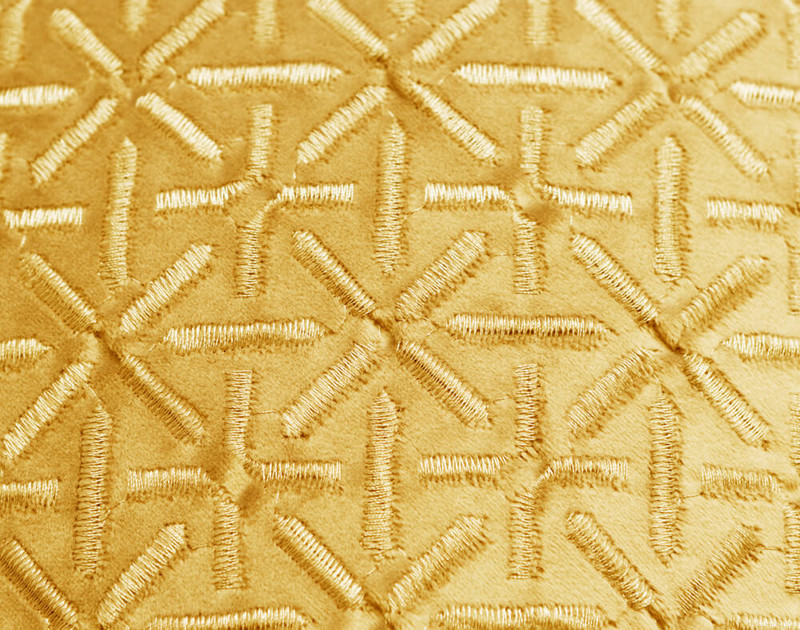 Close-up of the Trellis texture pattern on our Trellis Velvet Square Cushion Cover in Gold.