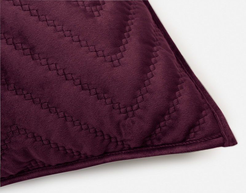 One closed corner of our Quilted Chevron Euro Sham in Plum.
