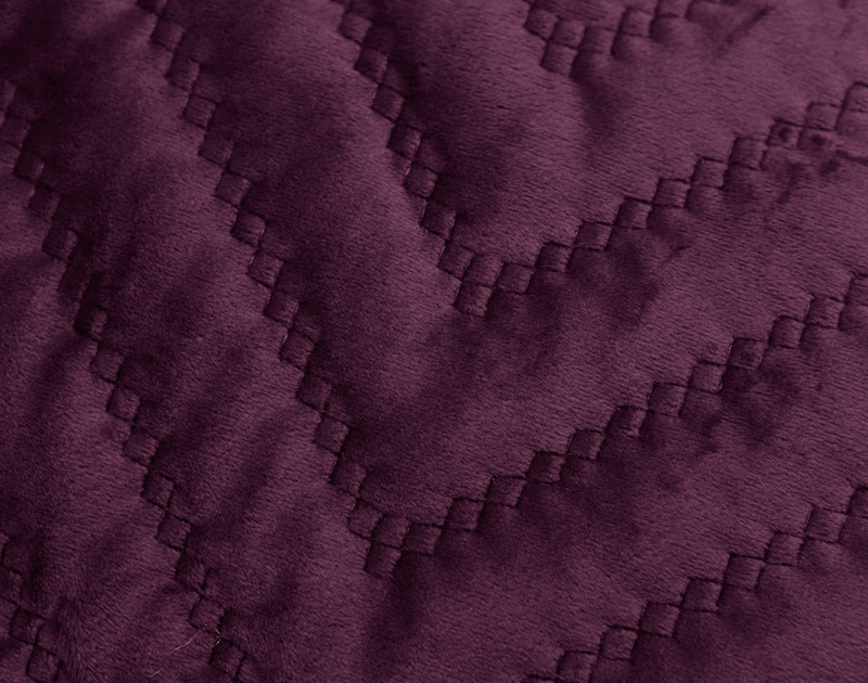 Close-up of the quilted texture of our Quilted Chevron Euro Sham in Plum.