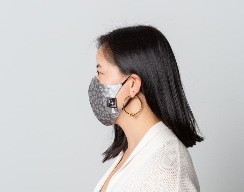Silver Leopard Silk Face Mask, side view.