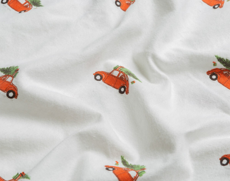 Close-up of the of the tiny holiday car on our Flannel Cotton Sheet Set in Festive Ride.