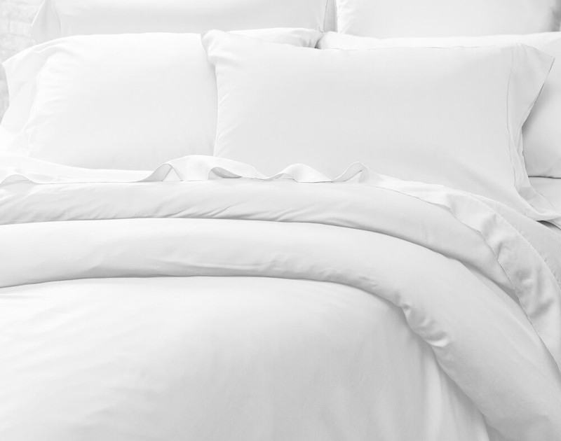 Full set of Cotton Blend Percale Sheets under a Cotton Blend Percale Duvet Cover.