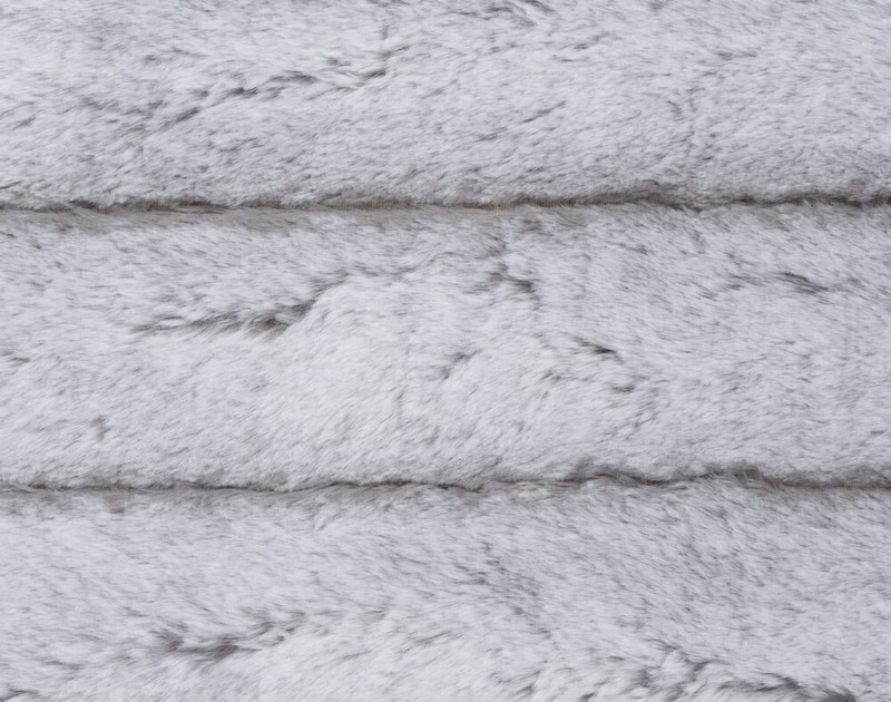 Front side of Tip-Dyed Faux Fur Throw Silver with ribbed fabric stripes and grey undertones.