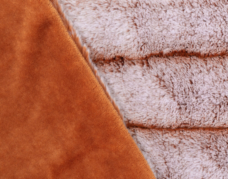 Close-up of Tip-Dyed Faux Fur Throw in Copper to show solid reverse texture.