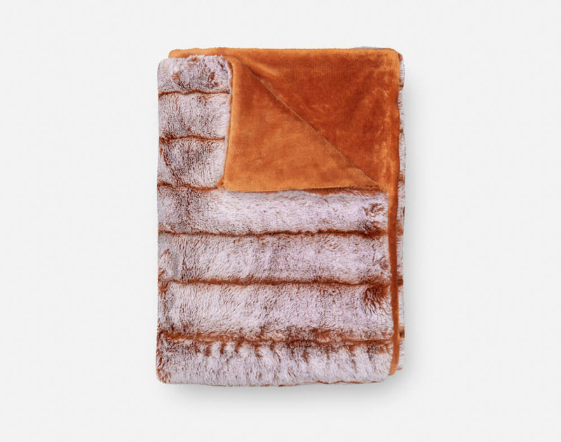 Tip-Dyed Faux Fur Throw in Copper folded into a small square.