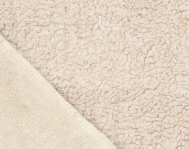 Folded close-up of Lambswool Faux Fur Throw in Natural to show solid side texture.