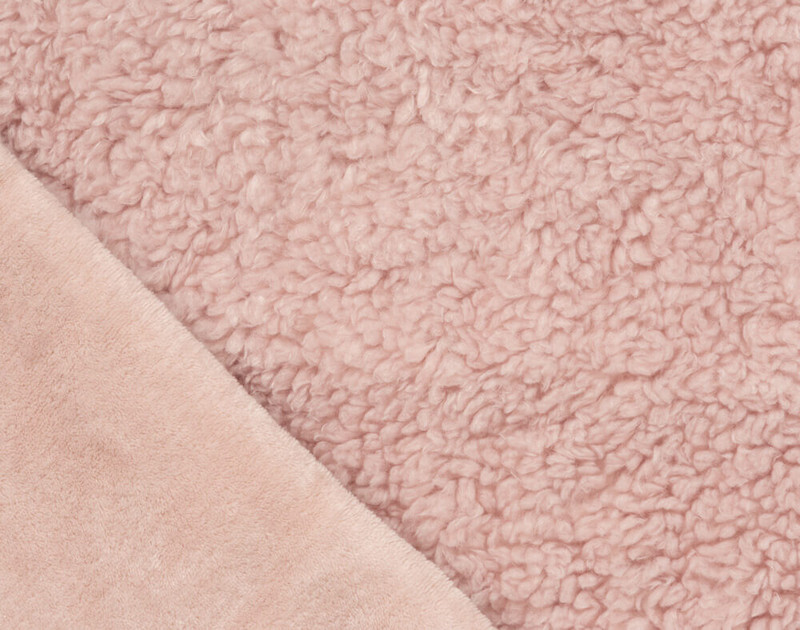 Folded close-up of Lambswool Faux Fur Throw in Blush to show solid side texture.