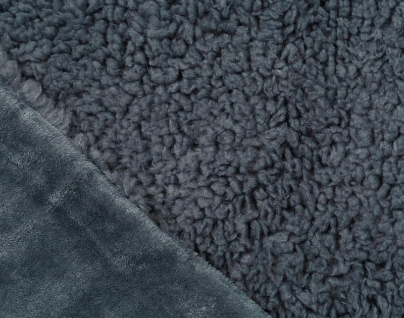 Folded close-up of Lambswool Faux Fur Throw in Thundercloud to show solid side texture.