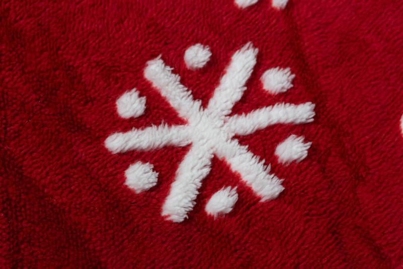 Close-up of snowflake on Sugar Snow Holiday Sherpa Throw.