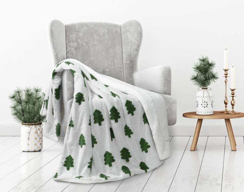 Our White Holiday Tree Time Throw in Sugar Snow, with stylish minimalist green trees.