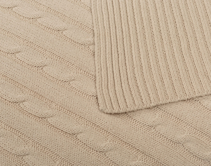 Close-up of folded corner on Cable Rib Knit Beige Throw in Natural.