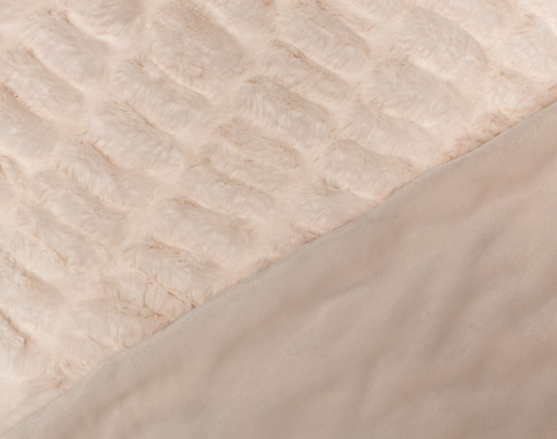 Close-up of textured front and smooth reverse side of Rabbit Carved Faux Fur Throw in Blush Pink.