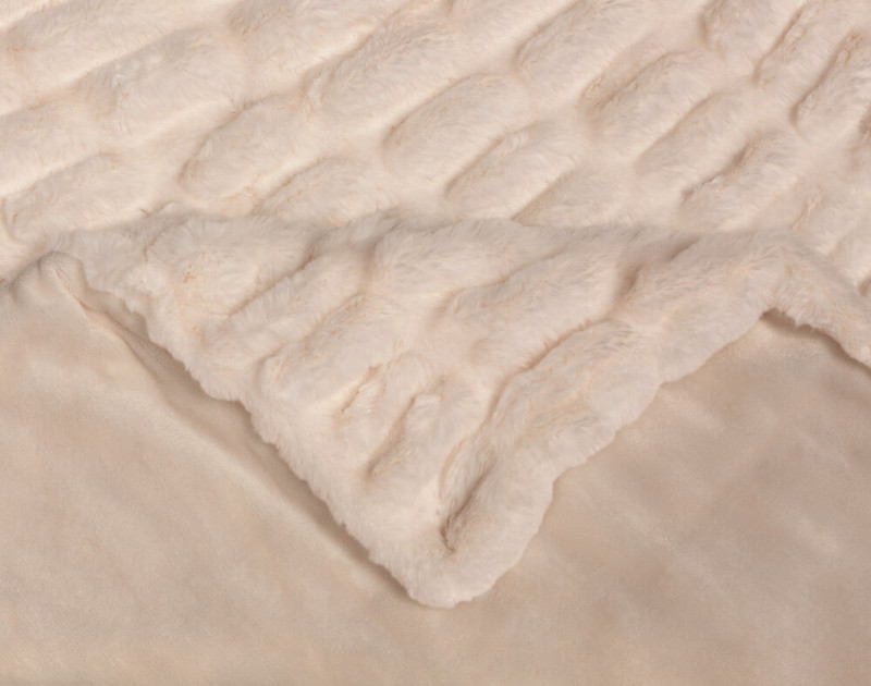 Corner fold of our Rabbit Carved Faux Fur Throw in Blush Pink.