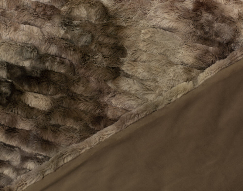 Close-up of textured front and smooth reverse side of Rabbit Carved Faux Fur Throw in Mink.