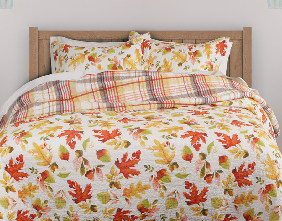 Redfield Cotton Quilt Set, a lively fall pattern with warm tones on a white background.