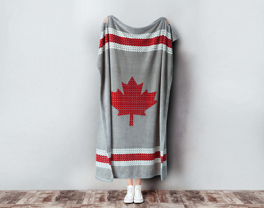 Chalet Sock Canada Fleece Throw being held up.