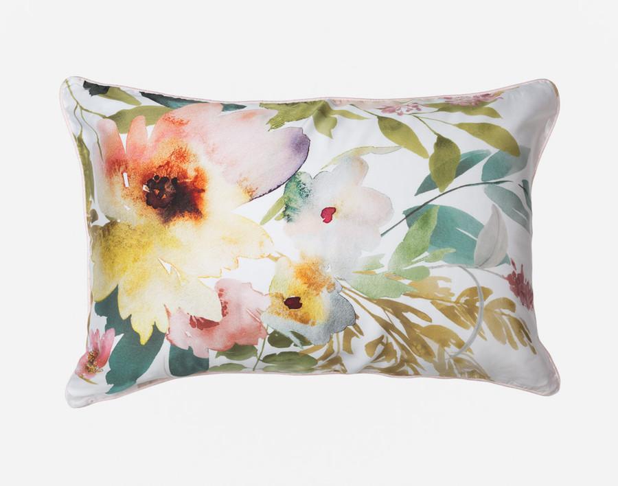 The Solange Pillow Sham features a vibrant watercolour floral design.
