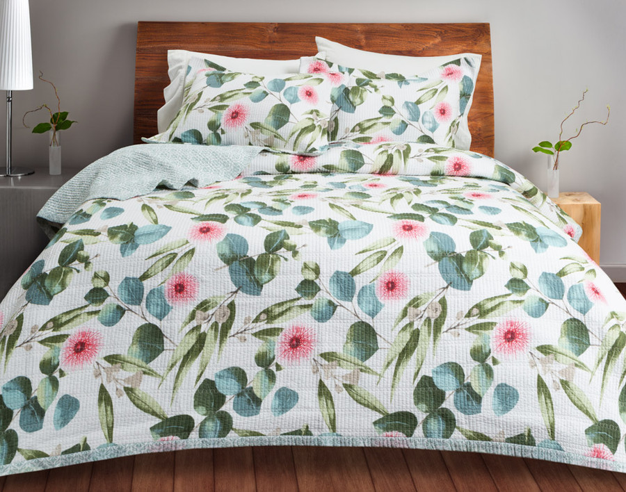 Sweeny Cotton Quilt Set, a charming floral design in shades of green and pink on a white background which reverses to a light green geometric print