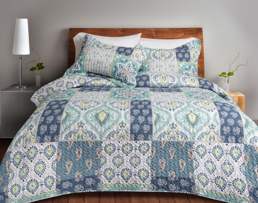 Bali Coverlet Set comes in shades of blue and green with pops of yellow, and is designed to look similar to a traditional patchwork quilt.
