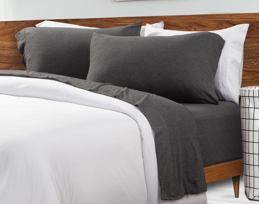 TENCEL™ Modal Jersey Sheet Set in Charcoal on bed with white duvet cover
