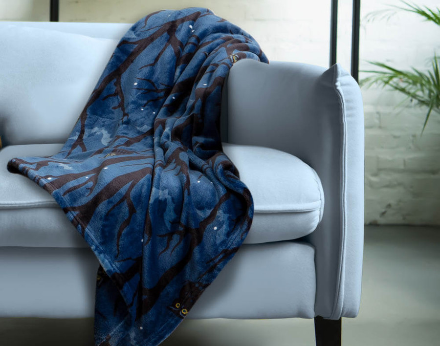 Halloween Fleece Throw in Night Owl features stylized owls, shadowy bats, and gloomy trees on a rich blue background.