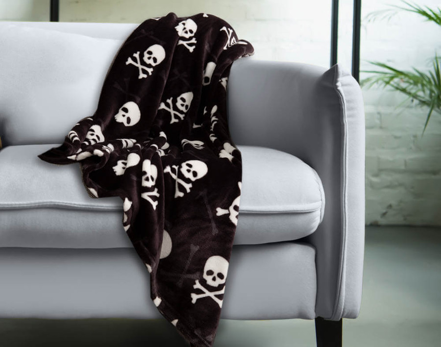 Skull & Bone Halloween Fleece Throw, featuring white skull and crossbones on a black background.