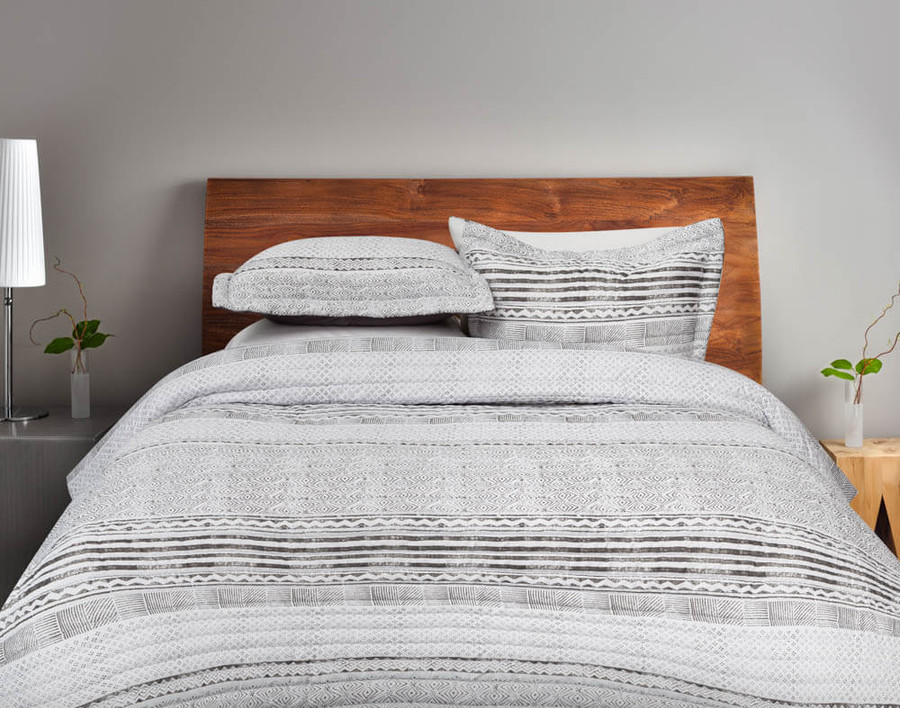 Nitva Coverlet Set features a bold grey geometric print on a white background.