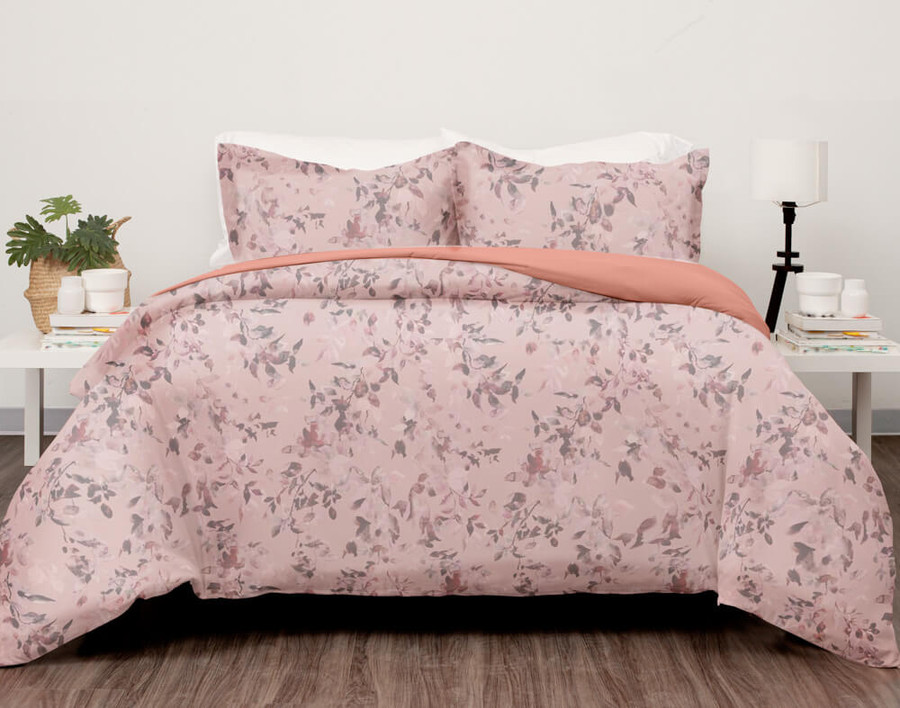 Carley Duvet Cover Set features a delicate floral print in shades of pink and brown on a soft pink background.