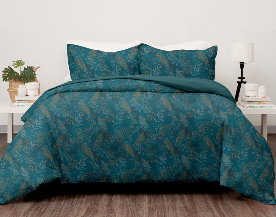 Denman Coverlet Set features foliage scattered across a deep teal background.