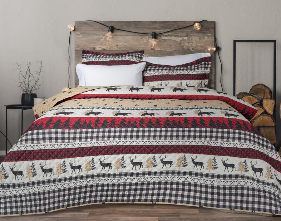 Trailhead Coverlet Set featuring woodland creatures on an alternating striped red, cream, and beige background.