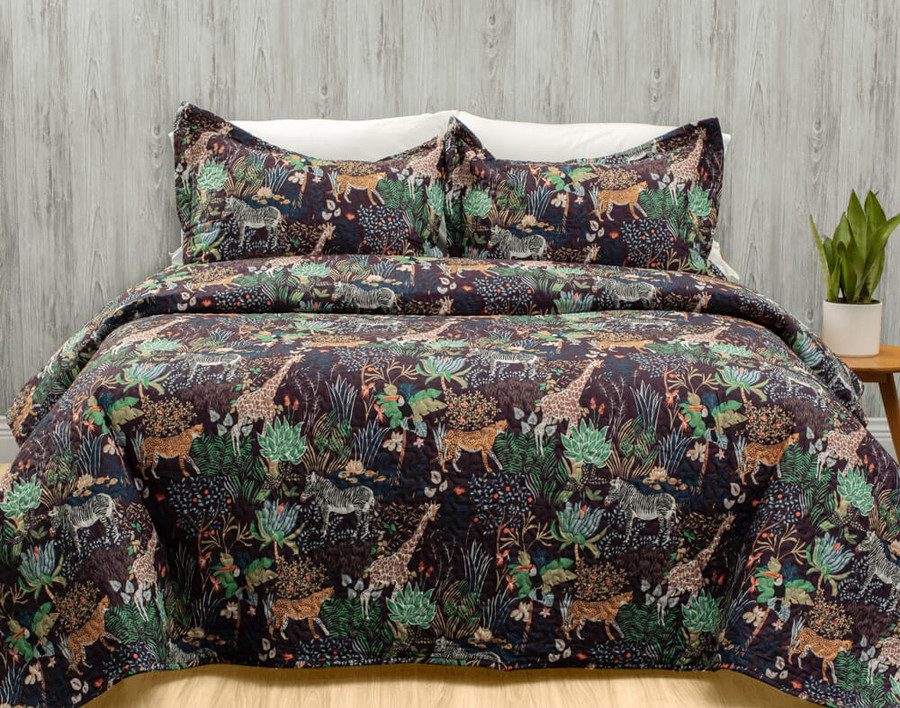 The Grasslands Coverlet Set, featuring African flora and fauna on a warm chocolate brown background.