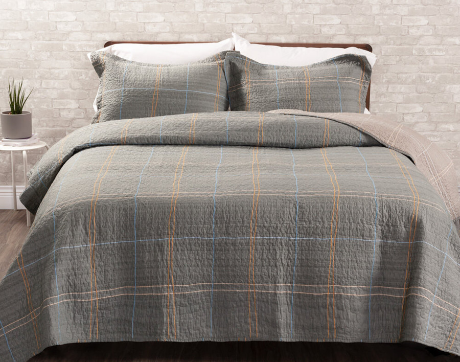 The Roma Cotton Quilt Set, featuring a contemporary plaid pattern in blue and orange on a soft grey background.
