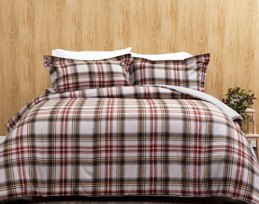 The Ashton Oversized Cotton Comforter Set, featuring a classic plaid print in red and black on a light grey background.