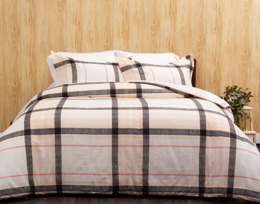 The Levon Oversized Cotton Comforter Set, featuring a classic plaid print in pink and black on an off-white.
