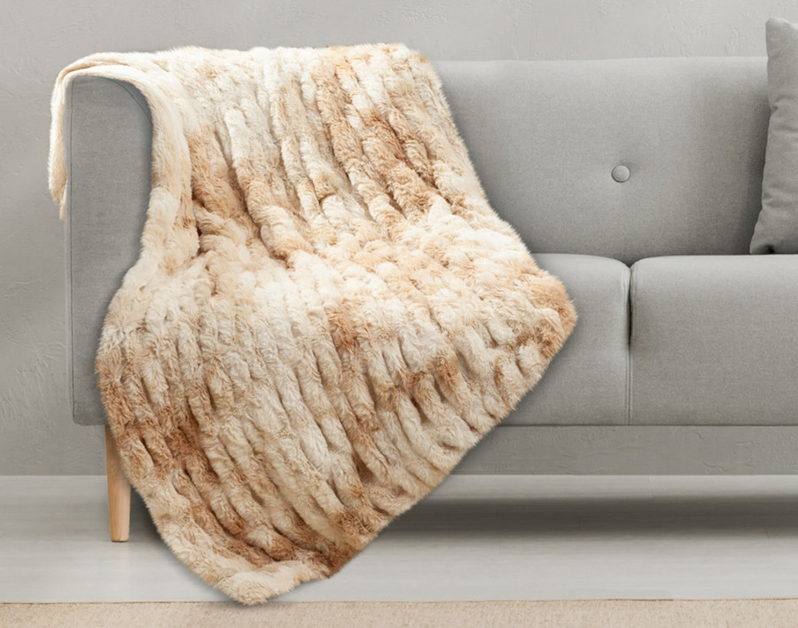 Carved Faux Fur Throw in Caramel, and off white punctuated with golden hues.