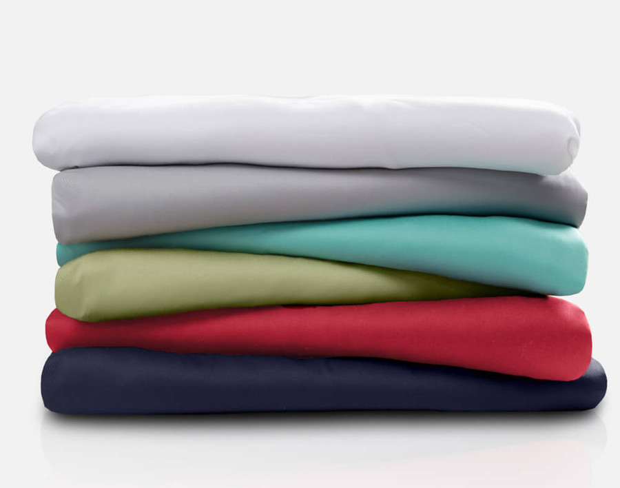 Cotton Rich Sheet Sets stacked in a tidy pile.