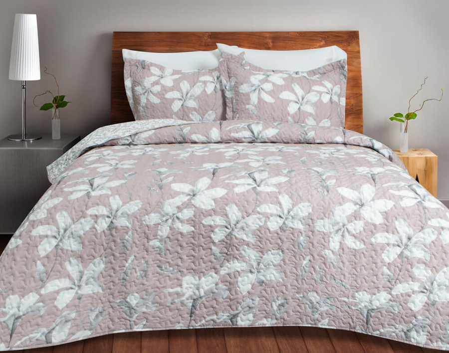 The Amaryllis Coverlet Set features a white amaryllis flower, botanical print on a blush pink background.