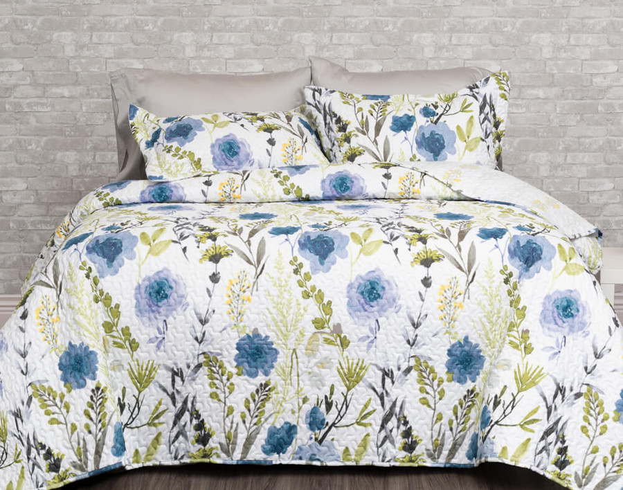 The Laken Coverlet Set features a blue and green botanical print on a white background.