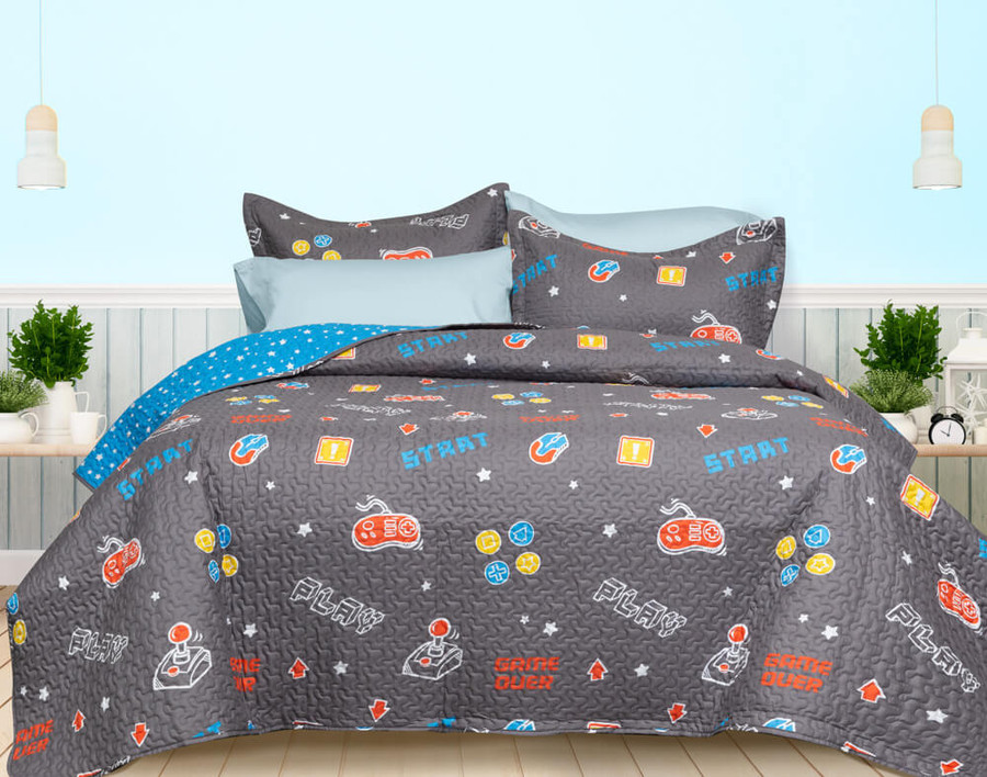 Game Over Coverlet Set, main side with video game print on a grey background.