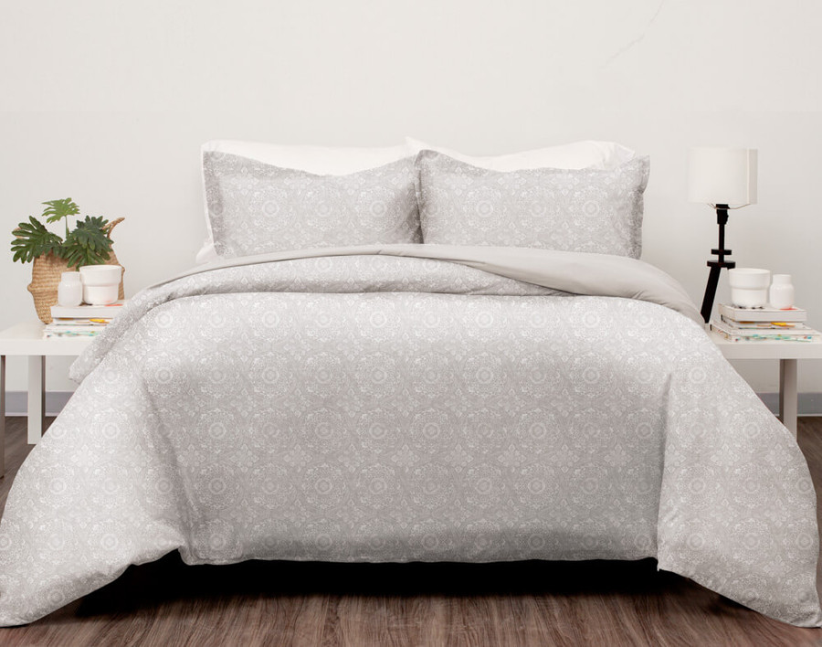Choose an understated gender-neutral print with our Sakara Duvet Cover Set, featuring etched white medallions on a soft pewter grey background.